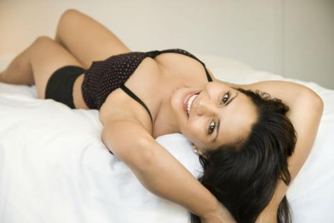sexy woman lying on bed in underwear