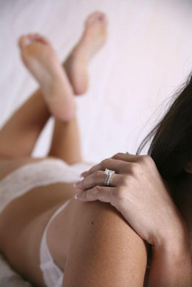 woman in underwear wearing wedding ring