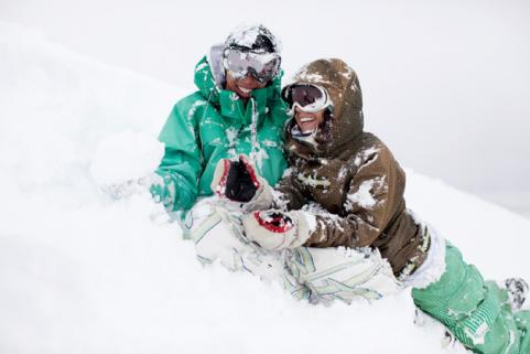 guy and girl going snowboarding