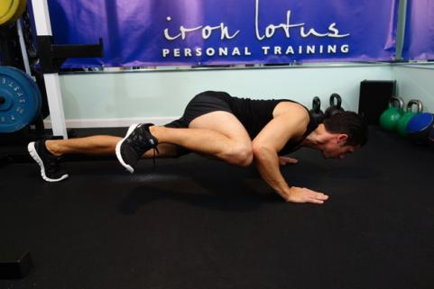 body weight training spiderman pushup