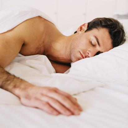 Man sleeping in a clean bed
