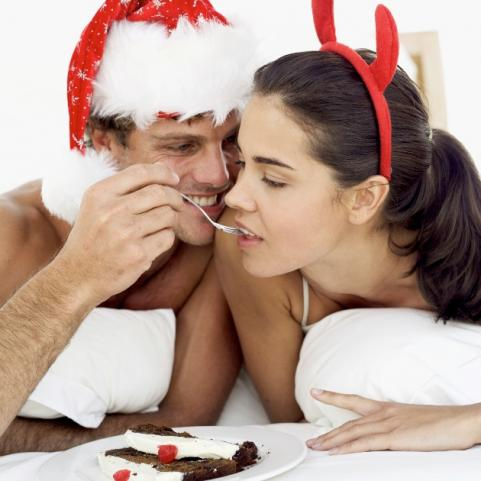hot holiday dates: sexy couple eating cake
