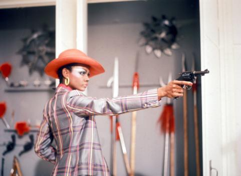 Tamara Dobson shoots gun in Cleopatra Jones