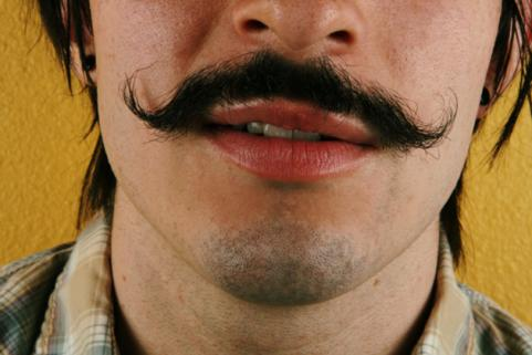 man with a long thick moustache