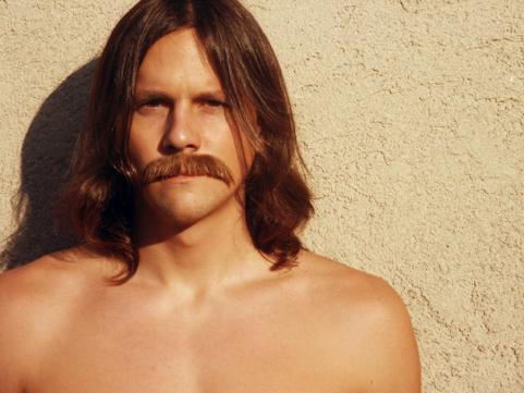 man with long hair and moustache