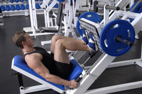 Man using squat press machine