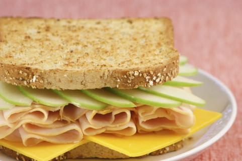 Turkey sandwich on whole wheat with cheese and apples