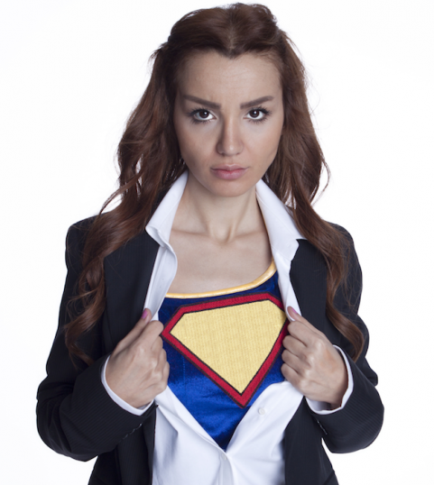 Girl in superman costume