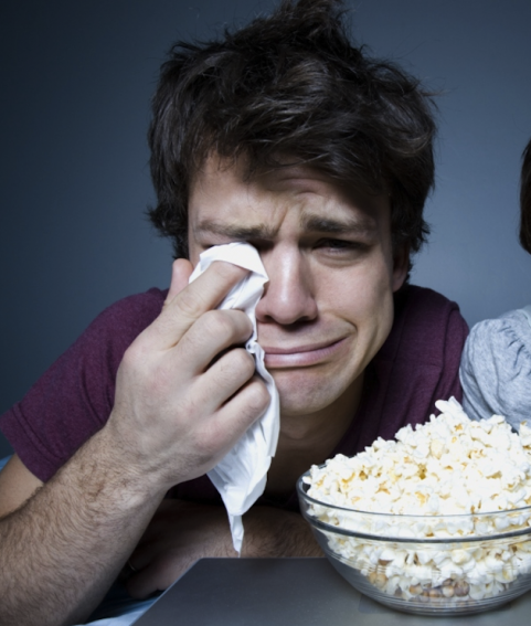 Man crying with popcorn