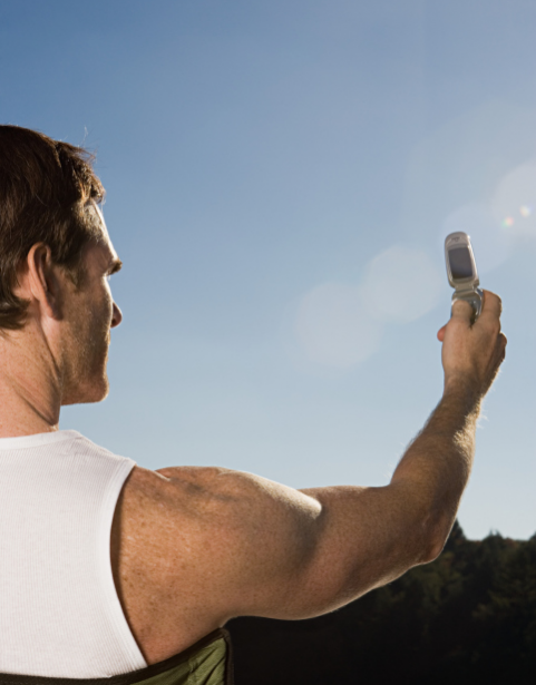 Man taking picture of himself with cell phone