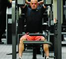 Todd Carmichael lifting on weight machine