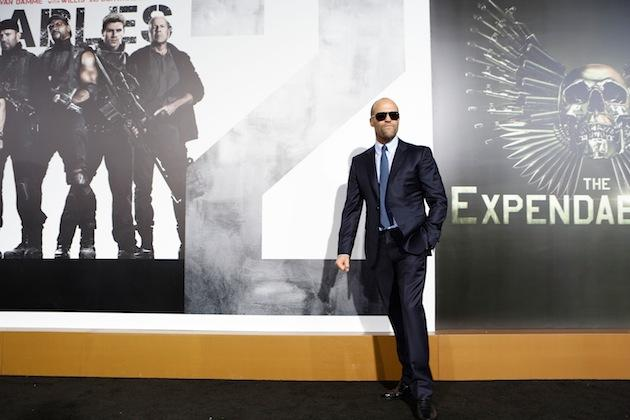 Jason Statham in front of Expendables sign