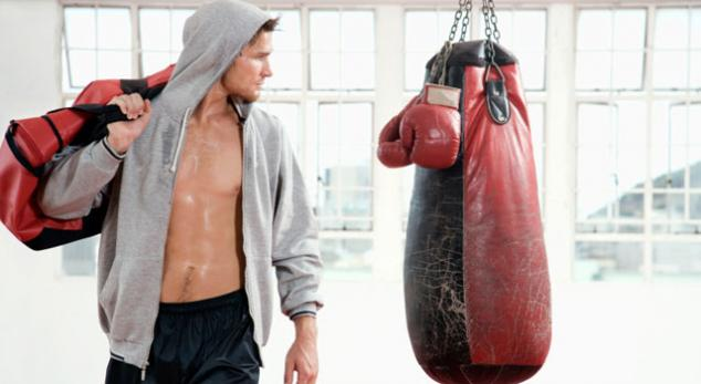man at the heavy bag