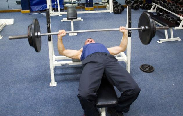 Man Bench Pressing