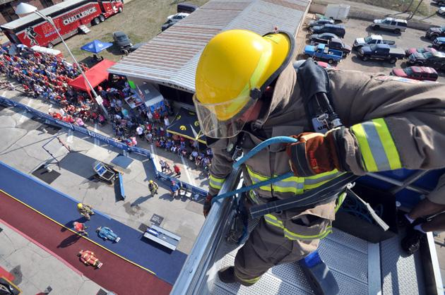 firefighter hoisting hose in Firefighter Combat Challenge