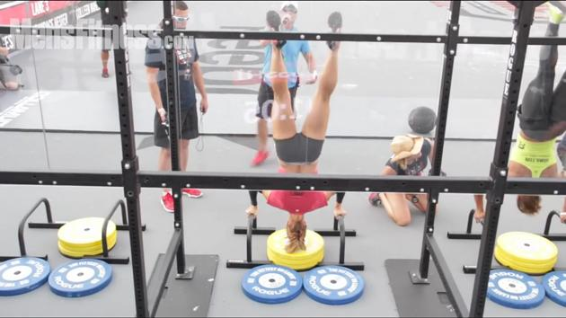 CrossFit Woman Doing Handstand Push-ups