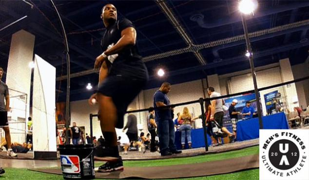 Former NFL player, D'Juan Woods throws a pitch in the Men's Fitness Ultimate Athlete event during Olympia Weekend in Las Vegas, Nevada