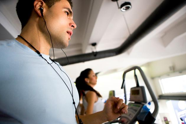 man running on treadmill listening to music