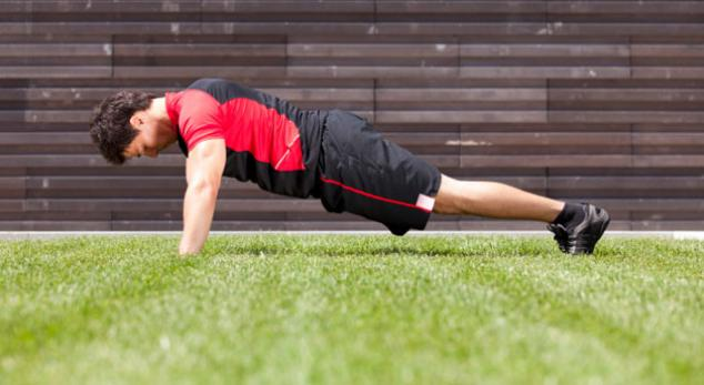 man performing push ups