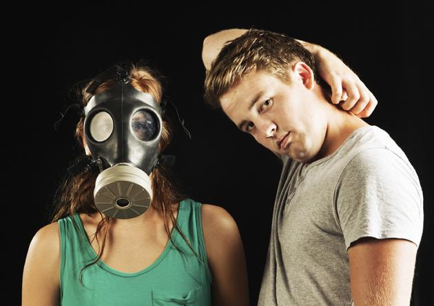 smelly guy and woman in gas mask