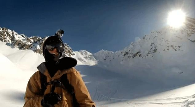 skier with gopro hero3 mounted on his helmet