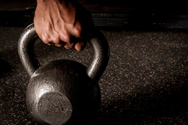 man holding a kettle bell