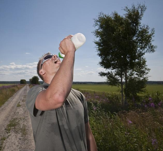 Man Outside With Sunglasses Drinking Water 