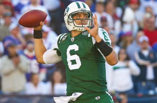 Mark Sanchez throwing a football