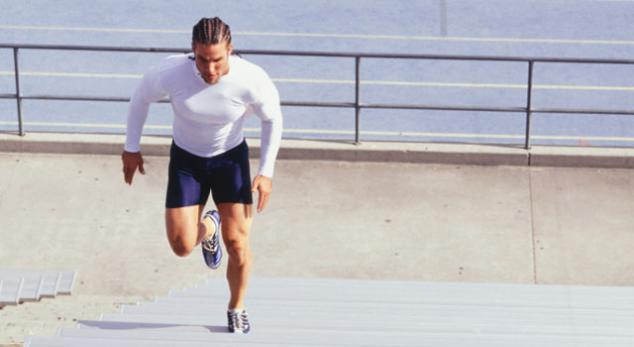 man running interval sprints up stairs