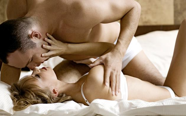 man and woman making out on bed