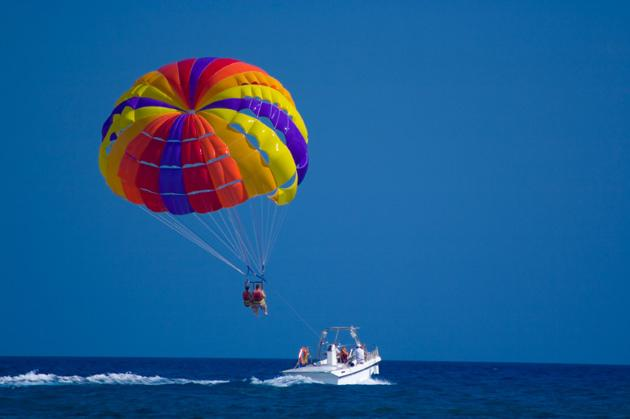 couple parasailing on active date