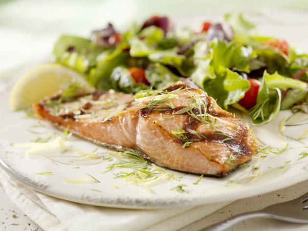 salmon on plate with mixed green salad