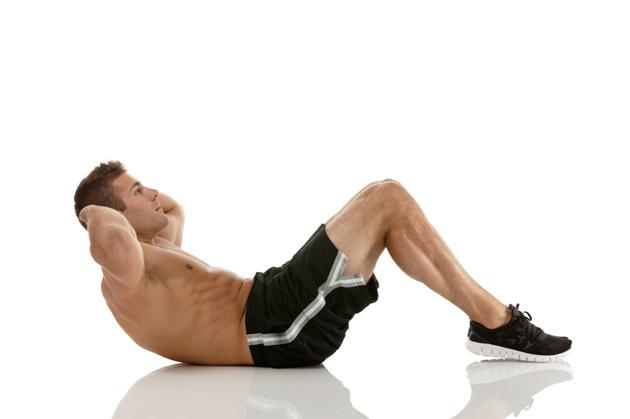 man doing crunch body weight exercise