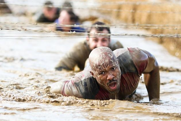 Man crawling through mud
