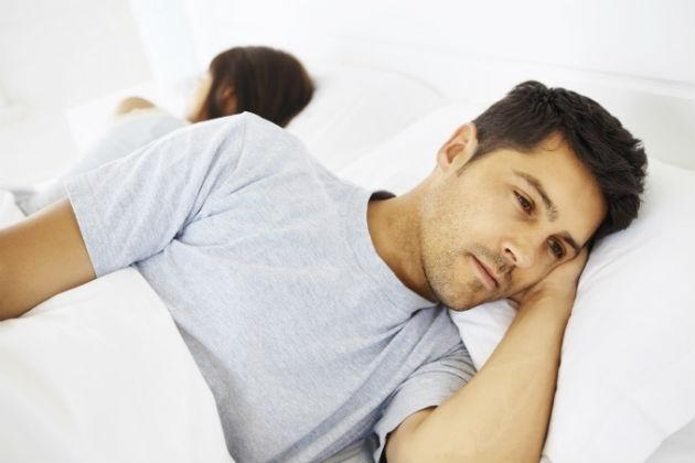 Man lying awake in bed