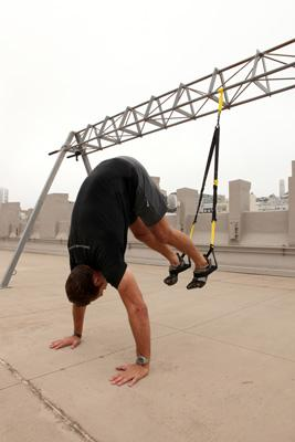man doing TRX exercises for full-body workout