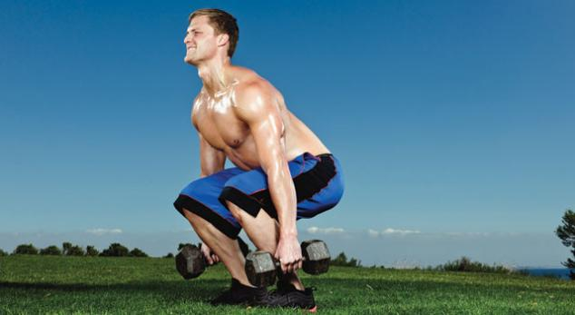 man performing dumbbell squat exercise