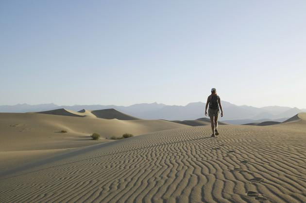 woman hiking alone in desert