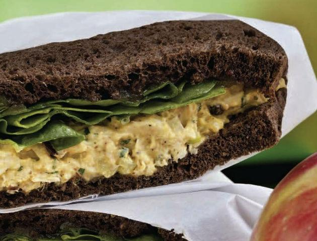 curried chicken salad sandwich on pumpernickel bread
