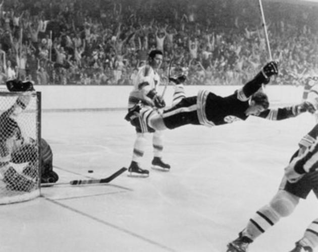 Defenceman Bobby Orr leaps across ice
