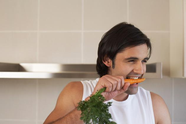 happy man eating a carrot