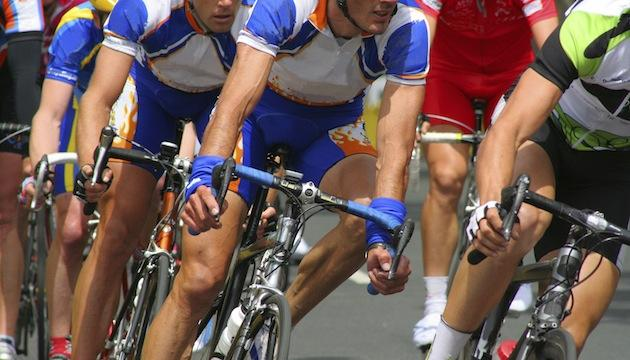 elite athletes - cyclists in a pack