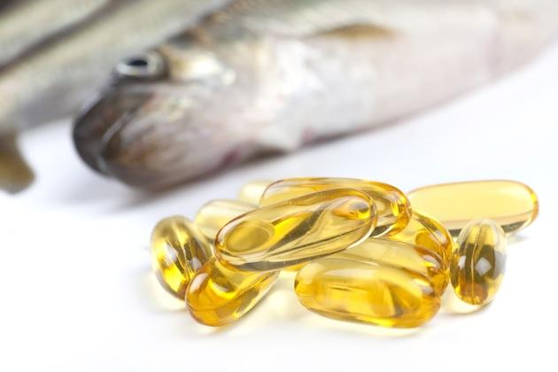 fish beside fish oil pills - rich in omega-3 fatty acids