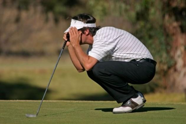 Man putting during golf