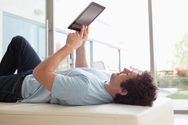man reading from an iPad