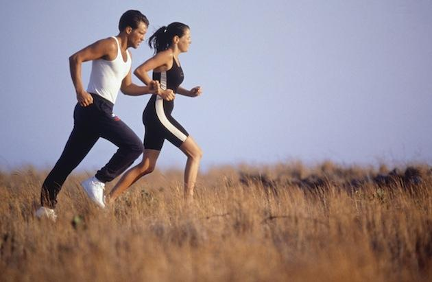 physical exercise: man and woman running across a field