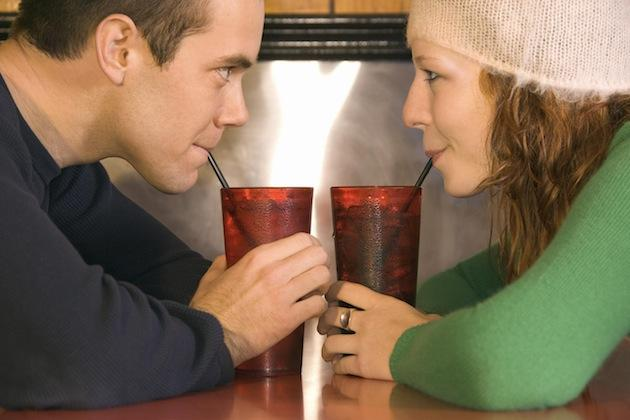 man and woman drinking soda