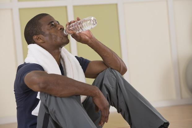 Man drinking water post workout