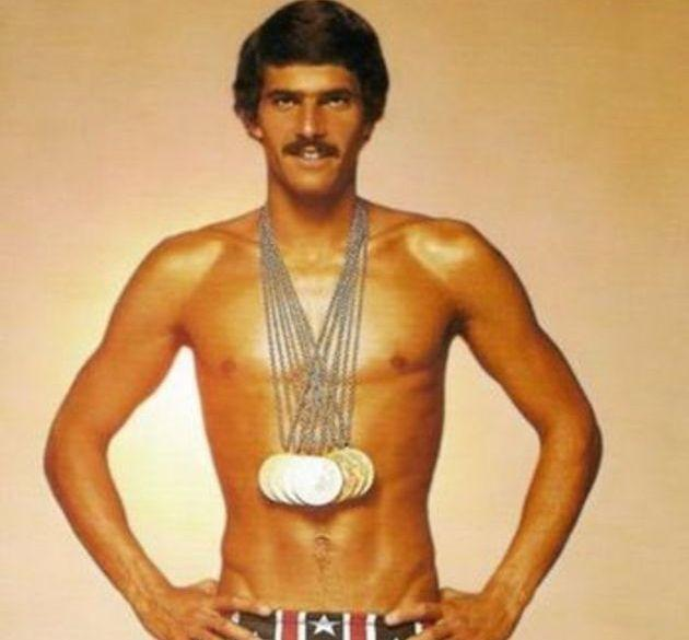 Swimmer Mark Spitz displays Olympic gold medals and enviable mustache