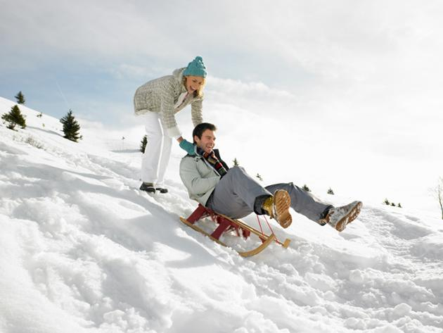 happy couple sledding